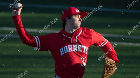Stock Image of Delaware State pitcher Jordon Haddaway throws against LaSalle during an NCAA baseball game, in Philadelphia
