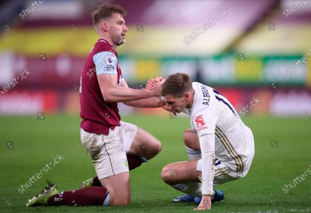 Burnley's Charlie Taylor (L) helps his opponent Leicester's Marc Albrighton (R) to get up  during the English Premier League soccer match between Burnley FC and Leicester City in Burnley, Britain, 03 March 2021.
