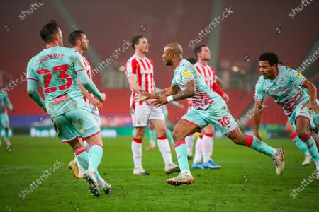 GOAL Swansea City forward Andre Ayew (10) runs away to celebrate after scoring the winner during the EFL Sky Bet Championship match between Stoke City and Swansea City at the Bet365 Stadium, Stoke-on-Trent