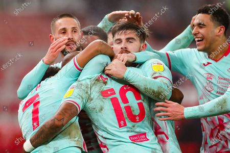GOAL Swansea City  players celebrate after Swansea City forward Andre Ayew (10) (hidden) had scored the winner during the EFL Sky Bet Championship match between Stoke City and Swansea City at the Bet365 Stadium, Stoke-on-Trent