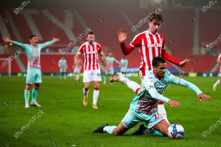 Swansea City defender Kyle Naughton (26) goes down to win  penalty during the EFL Sky Bet Championship match between Stoke City and Swansea City at the Bet365 Stadium, Stoke-on-Trent