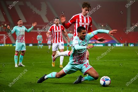 Stock Picture of Swansea City defender Kyle Naughton (26) goes down to win  penalty during the EFL Sky Bet Championship match between Stoke City and Swansea City at the Bet365 Stadium, Stoke-on-Trent