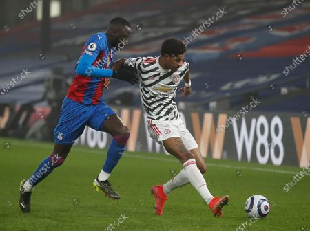 Manchester United's Marcus Rashford (R) in action against Crystal Palace's Cheikhou Kouyate (L) during the English Premier League soccer match between Crystal Palace and Manchester United in London, Britain, 03 March 2021.
