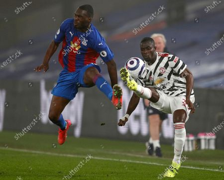 Manchester United's Eric Bailly (R) in action against Crystal Palace's Christian Benteke (L) during the English Premier League soccer match between Crystal Palace and Manchester United in London, Britain, 03 March 2021.