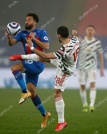 Manchester United's Bruno Fernandes (R) in action against Crystal Palace's Andros Townsend (L) during the English Premier League soccer match between Crystal Palace and Manchester United in London, Britain, 03 March 2021.