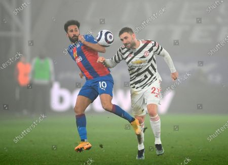 Manchester United's Luke Shaw (R) in action against Crystal Palace's Andros Townsend (L) during the English Premier League soccer match between Crystal Palace and Manchester United in London, Britain, 03 March 2021.