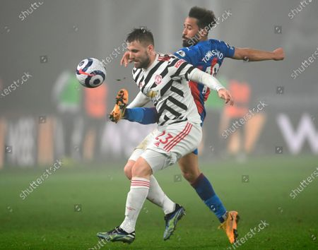 Manchester United's Luke Shaw (L) in action against Crystal Palace's Andros Townsend (R) during the English Premier League soccer match between Crystal Palace and Manchester United in London, Britain, 03 March 2021.