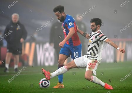 Manchester United's Bruno Fernandes (R) in action against 72Crystal Palace's Andros Townsend (L) during the English Premier League soccer match between Crystal Palace and Manchester United in London, Britain, 03 March 2021.