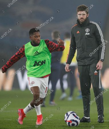 Manchester United assistant manager Michael Carrick (R) and Fred (L) in action during the warm-up ahead of the English Premier League soccer match between Crystal Palace and Manchester United in London, Britain, 03 March 2021.