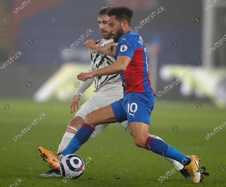 Crystal Palace's Andros Townsend (R) in action against Manchester United's Luke Shaw (L) during the English Premier League soccer match between Crystal Palace and Manchester United in London, Britain, 03 March 2021.