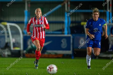 Toni Duggan (#18 Atletico Madrid) and Millie Bright (#4 Chelsea) during the UEFA Womens Champions League Round of 16 1st leg match between Chelsea and Atletico Madrid at Cherry Red Records Stadium
