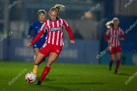 Toni Duggan (#18 Atletico Madrid) kicks the ball during the UEFA Womens Champions League Round of 16 1st leg match between Chelsea and Atletico Madrid at Cherry Red Records Stadium