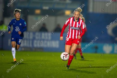 Toni Duggan (#18 Atletico Madrid) runs with the ball during the UEFA Womens Champions League Round of 16 1st leg match between Chelsea and Atletico Madrid at Cherry Red Records Stadium