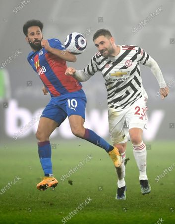 Manchester United's Luke Shaw, right, and Crystal Palace's Andros Townsend challenge for the ball during the English Premier League soccer match between Crystal Palace and Manchester United at Selhurst Park stadium in London, England