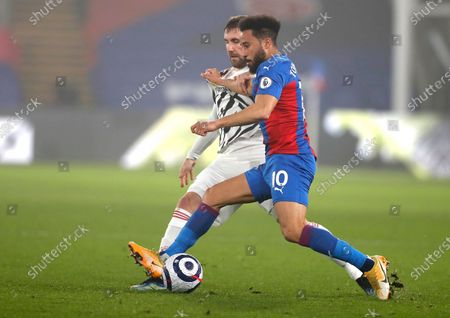 Manchester United's Luke Shaw, left, and Crystal Palace's Andros Townsend challenge for the ball during the English Premier League soccer match between Crystal Palace and Manchester United at Selhurst Park stadium in London, England