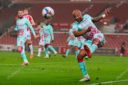 Andre Ayew of Swansea City makes a clearing kick