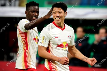 Leipzig's Hee-chan Hwang (R) celebrates with his teammate after scoring the 2-0 lead during the German DFB Cup quarter final soccer match between RB Leipzig and VfL Wolfsburg in Leipzig, Germany, 03 March 2021.