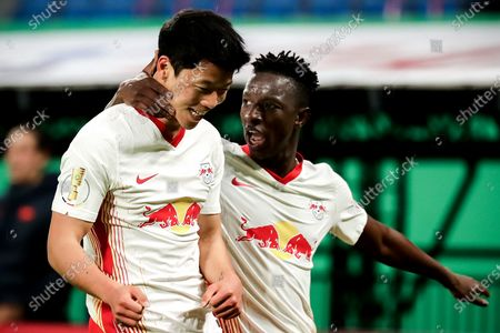 Leipzig's Hee-chan Hwang (L) celebrates with his teammate after scoring the 2-0 lead during the German DFB Cup quarter final soccer match between RB Leipzig and VfL Wolfsburg in Leipzig, Germany, 03 March 2021.