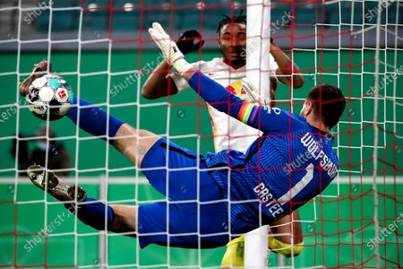 Wolfsburg's goalkeeper Koen Casteels saves the ball during the German DFB Cup quarter final soccer match between RB Leipzig and VfL Wolfsburg in Leipzig, Germany, 03 March 2021.