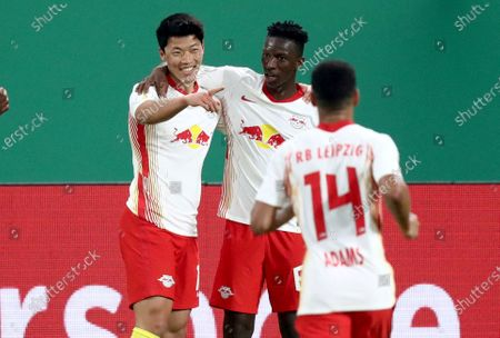 Leipzig's Hwang Hee-chan, left, celebrates after scoring his side's second goal during the German soccer cup, DFB Pokal, quarter final match between RB Leipzig and VfL Wolfsburg in Leipzig, Germany