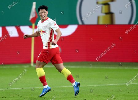 Leipzig's Hwang Hee-chan celebrates after scoring his side's second goal during the German soccer cup, DFB Pokal, quarter final match between RB Leipzig and VfL Wolfsburg in Leipzig, Germany