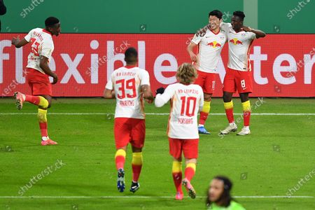 Hee-Chan Hwang of RB Leipzig (2R) celebrates with Amadou Haidara after scoring their side's second goal during the DFB Cup quarter final soccer match between RB Leipzig and VfL Wolfsburg in Leipzig, Germany, 03 March 2021.