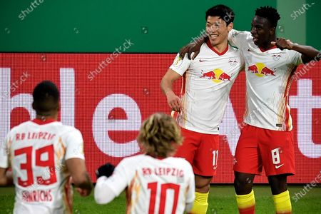 Leipzig's Hee-Chan Hwang (2-R) celebrates with his teammates after scoring the 2-0 lead during the German DFB Cup quarter final soccer match between RB Leipzig and VfL Wolfsburg in Leipzig, Germany, 03 March 2021.