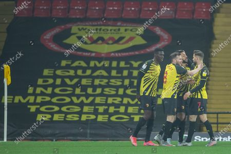 Watford players congratulate Andre Gray of Watford after he scored Watford's second goal