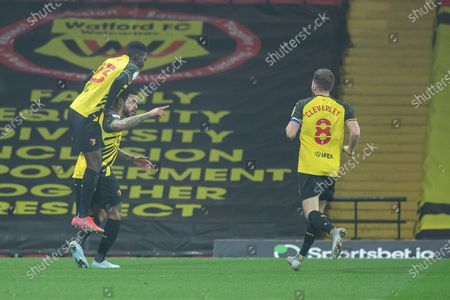 Ismaila Sarr of Watford jumps on goal scorer Andre Gray of Watford after his second goal