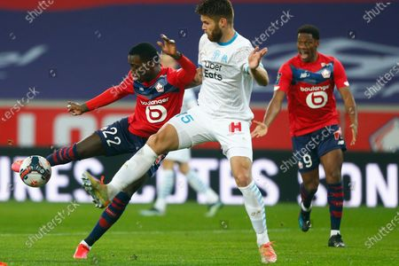 Lille's Timothy Weah, left, is challenged by Marseille's Duje Caleta-Car during the French League One soccer match between Lille and Marseille at the Stade Pierre Mauroy stadium in Villeneuve-d'Ascq, France