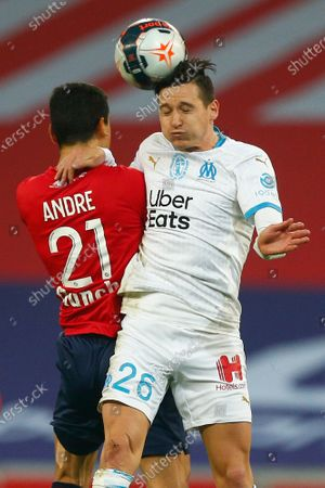 Marseille's Florian Thauvin, right, jumps for a header with Lille's Benjamin Andre during the French League One soccer match between Lille and Marseille at the Stade Pierre Mauroy stadium in Villeneuve-d'Ascq, France
