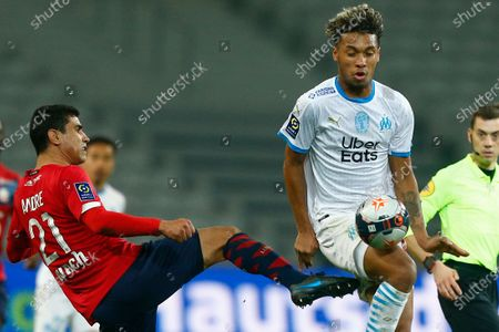 Marseille's Boubacar Kamara, right, is challenged by Lille's Benjamin Andre during the French League One soccer match between Lille and Marseille at the Stade Pierre Mauroy stadium in Villeneuve-d'Ascq, France