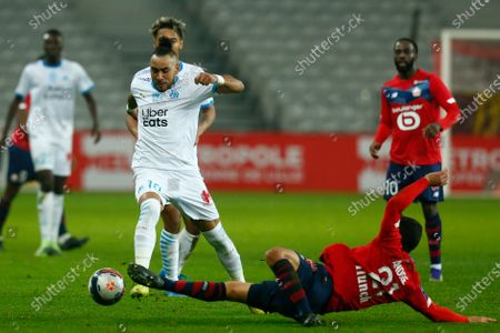 Marseille's Dimitri Payet, left, is challenged by Lille's Benjamin Andre during the French League One soccer match between Lille and Marseille at the Stade Pierre Mauroy stadium in Villeneuve-d'Ascq, France