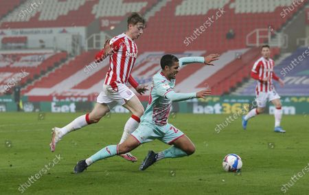 Kyle Naughton of Swansea goes down in the penalty area under the challenge of Jack Clarke of Stoke City