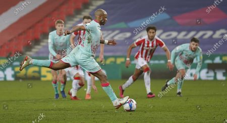 Andre Ayew of Swansea scores a penalty