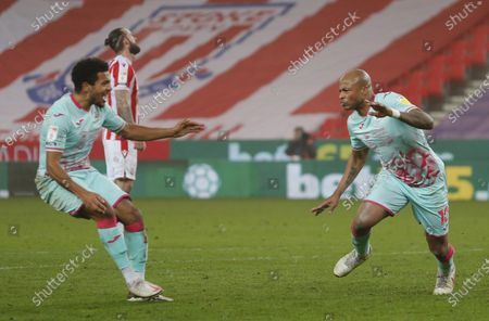 Andre Ayew of Swansea celebrates scoring a penalty with Korey Smith of Swansea