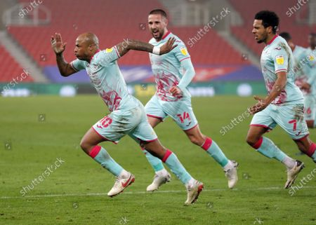 Stock Image of Andre Ayew of Swansea celebrates scoring a penalty with Korey Smith and Conor Hourihane