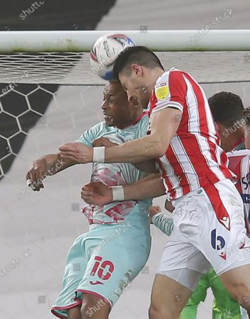 Clash of heads between Danny Batth of Stoke City and Andre Ayew of Swansea leading to Danny Batth of Stoke City being subbed at half time with a nasty wound