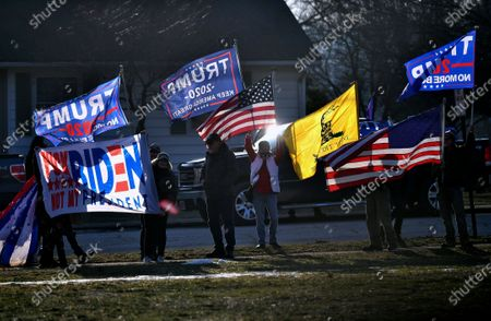 Supporters of formerPresident Donald Trump demonstrate outside as first lady Jill Biden and Education Secretary Miguel Cardona visit Fort LeBoeuf Middle School in Waterford, Pa