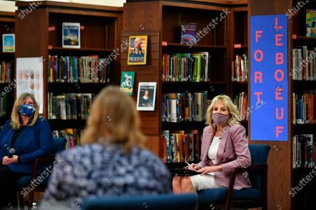 First lady Jill Biden listens to parents as she tours Fort LeBoeuf Middle School in Waterford, Pa