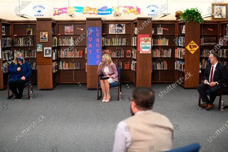 First lady Jill Biden and Education Secretary Miguel Cardona listen to parents as she tours Fort LeBoeuf Middle School in Waterford, Pa