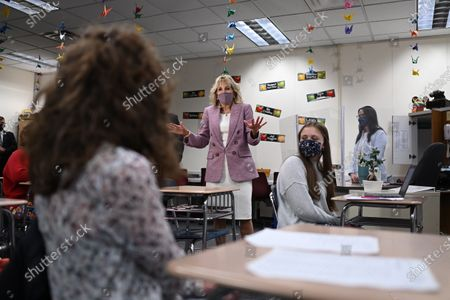 First lady Jill Biden speaks with students as she tours Fort LeBoeuf Middle School in Waterford, Pa