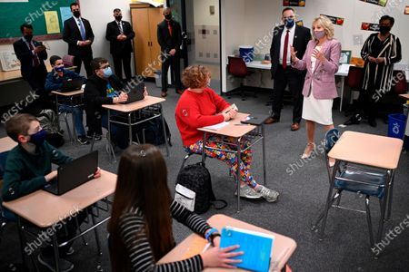 First lady Jill Biden speaks to students as she and Education Secretary Miguel Cardona tour Fort LeBoeuf Middle School in Waterford, Pa