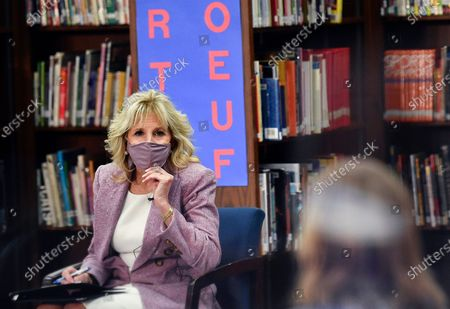 Stock Picture of First lady Jill Biden speaks to parents as she tours Fort LeBoeuf Middle School in Waterford, Pa