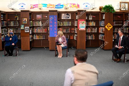 Stock Photo of First lady Jill Biden and Education Secretary Miguel Cardona listen to parents as she tours Fort LeBoeuf Middle School in Waterford, Pa