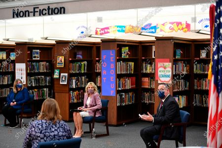 First lady Jill Biden and Education Secretary Miguel Cardona speak to parents as she tours Fort LeBoeuf Middle School in Waterford, Pa