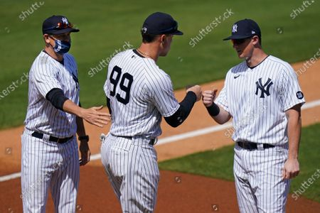 Stock Image of New York Yankees' Manager Aaron Boone, left, stands with Aaron Judge, center, and DJ LeMahieu as they are announced before a spring baseball game against the Toronto Blue Jays, in Tampa, Fla