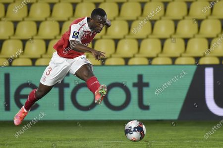 Reims Ivorian defender Ghislain Konan shoots and scores a goal during the Ligue 1 football match between Nantes (FC Nantes) and Reims (Stade de Reims) at the La Beaujoire Stadium in Nantes