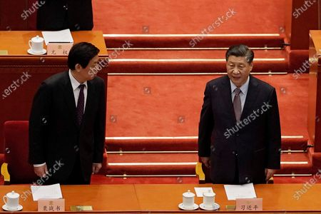 Chinese President Xi Jinping, right, chats with Li Zhanshu, Chairman of National People's Congress, as they arrive for the opening session of Chinese People's Political Consultative Conference (CPPCC) at the Great Hall of the People in Beijing
