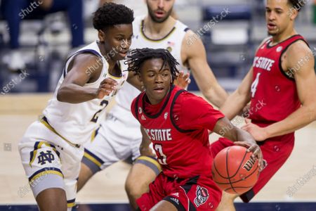 North Carolina State's Cam Hayes (3) gets pressure from Notre Dame's Trey Wertz (2) during the first half of an NCAA college basketball game, in South Bend, Ind